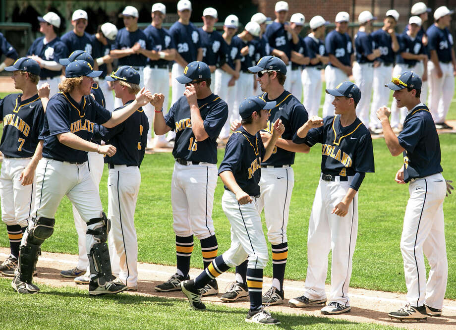 Midland players high five each other while being introduced before their state semifinal game against Grosse Pointe South on Thursday, June 14, 2018 at Michigan State University. Midland fell 10-0. (Mackenzie Brockman/for the Daily News) Photo: (Mackenzie Brockman/for The Daily News)