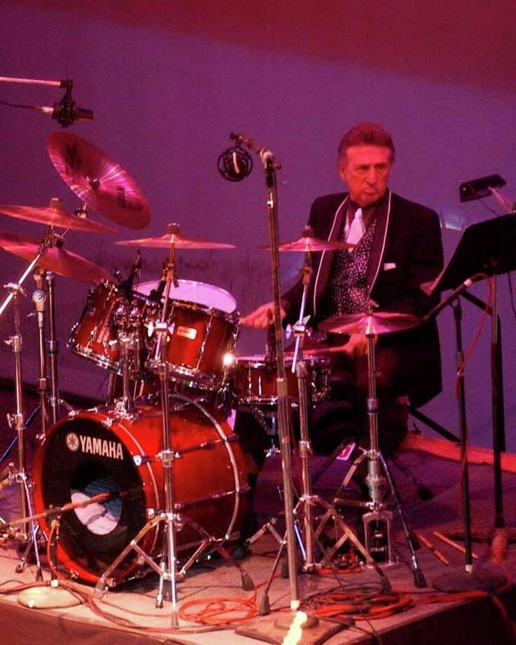 FILE- In this Oct. 16, 2004 file photo, longtime Elvis Presley drummer D.J. Fontana performs at the 50th anniversary celebration concert of Elvis Presley's first performance at the Louisiana Hayride in Sherveport, La.  Fontana, the drummer who helped launch rock 'n' roll as Elvis Presley's sideman, has died at 87, his wife said Thursday, June 14, 2018. Karen Fontana told The Associated Press that her husband died Wednesday, June 13 in his sleep in Nashville.  (Robert Ruiz/The Shreveport Times via AP) Photo: Robert Ruiz / The Shreveport Times