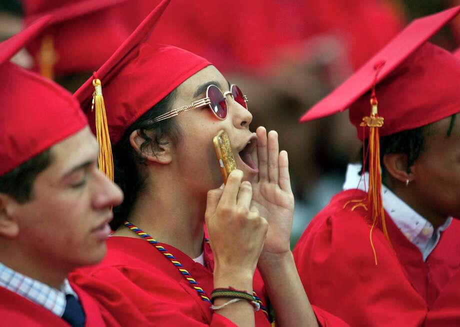 Graduate Noah Anderson cheers for a fellow graduate during Stratford High School's 129th Commencement in Stratford, Conn., on Thursday, June 14, 2018. Photo: Christian Abraham, Hearst Connecticut Media / Connecticut Post