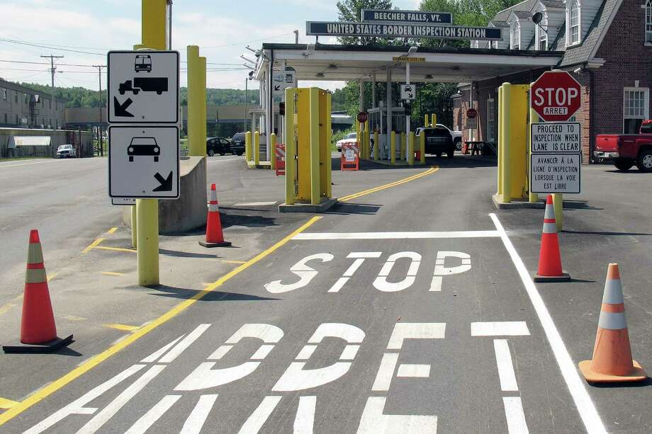 FILE - This Aug. 2, 2017 file photo shows the U.S. border crossing post at the Canadian border between Vermont and Quebec, Canada, at Beecher Falls, Vt. For the first time in decades, one of the world's most durable and amicable alliances faces serious strain as Canadians _ widely seen as some of the nicest, politest people on Earth _ absorb Donald Trump's insults against their prime minister and attacks on their country's trade policies. (AP Photo/Wilson Ring) Photo: Wilson Ring / Copyright 2017 The Associated Press. All rights reserved.