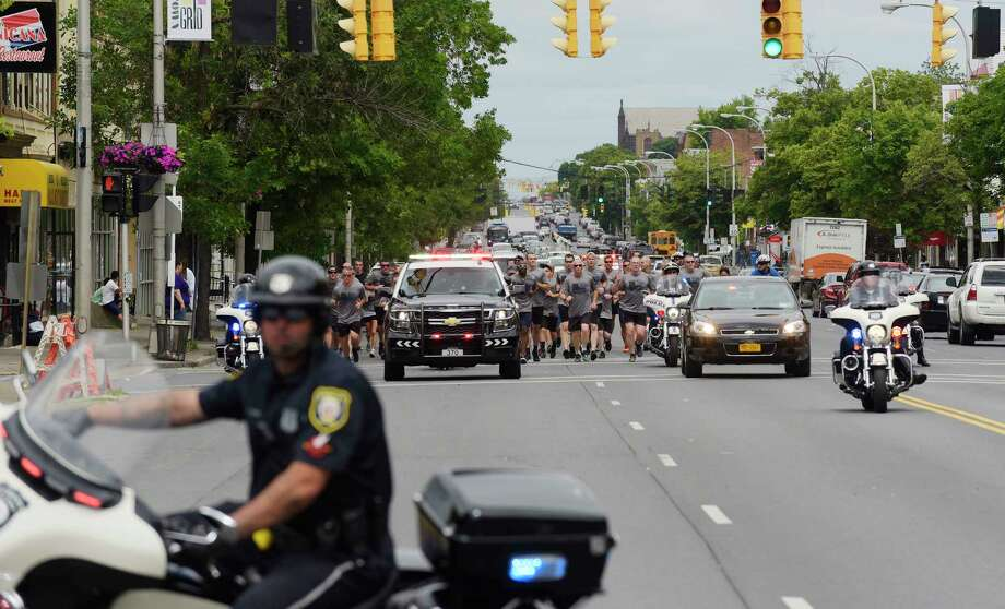 Members of law enforcement driving vehicles and motorcycles lead runners taking part in the  Special Olympics Law Enforcement Torch Run down Central Ave. on Thursday, June 14, 2018, in Albany, N.Y. The runners left Veterans Park in Schenectady in the morning and ended the torch run at Albany City Hall for a noon event. This year's Special Olympics Summer Games are hosted by Siena College.   (Paul Buckowski/Times Union) Photo: Paul Buckowski / (Paul Buckowski/Times Union)