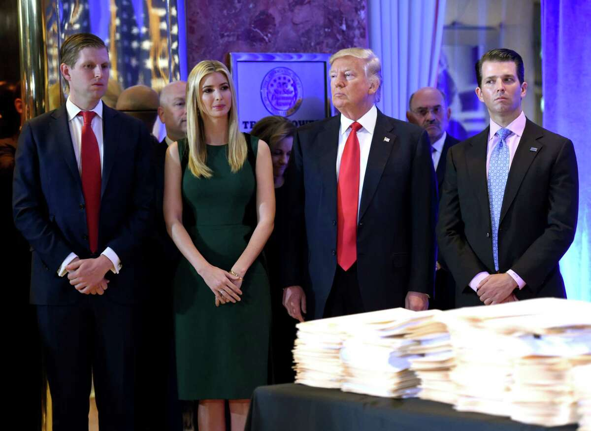 """(FILES) In this file photo taken on January 11, 2017 then US President-elect Donald Trump along with his children Eric(L) Ivanka and Donald Jr. arrive for a press conference at Trump Tower in New York. New York State announced a lawsuit on June 14, 2018 against US President Donald Trump, his sons and daughter over alleged """"persistent illegal conduct"""" at their family foundation for more than a decade. The lawsuit accused the Donald J. Trump foundation of """"extensive unlawful political coordination with the Trump presidential campaign, repeated and willful self-dealing transactions to benefit Mr. Trump's personal and business interests, and violations of basic legal obligations for non-profit foundations."""" / AFP PHOTO / Timothy A. CLARYTIMOTHY A. CLARY/AFP/Getty Images"""