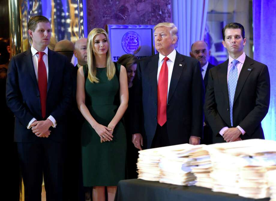 """(FILES) In this file photo taken on January 11, 2017 then US President-elect Donald Trump along with his children Eric(L) Ivanka and Donald Jr. arrive for a press conference  at Trump Tower in New York. New York State announced a lawsuit on June 14, 2018 against US President Donald Trump, his sons and daughter over alleged """"persistent illegal conduct"""" at their family foundation for more than a decade. The lawsuit accused the Donald J. Trump foundation of """"extensive unlawful political coordination with the Trump presidential campaign, repeated and willful self-dealing transactions to benefit Mr. Trump's personal and business interests, and violations of basic legal obligations for non-profit foundations.""""  / AFP PHOTO / Timothy A. CLARYTIMOTHY A. CLARY/AFP/Getty Images Photo: TIMOTHY A. CLARY / AFP or licensors"""
