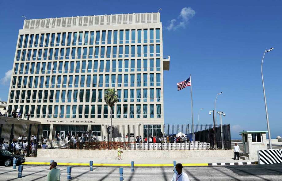 "FILE - In this Aug. 14, 2015, file photo, a U.S. flag flies at the U.S. embassy in Havana, Cuba. The United States is renewing calls for the Cuban government to determine the source of ""attacks"" on U.S. diplomats in Cuba that have affected some two dozen people. At a senior-level meeting with Cuban officials in Washington on June 14, 2018, the State Department said it had again raised the issue, which has prompted a significant reduction in staffing at the U.S. Embassy in Havana.(AP Photo/Desmond Boylan, File) Photo: Desmond Boylan / Copyright 2017 The Associated Press. All rights reserved."