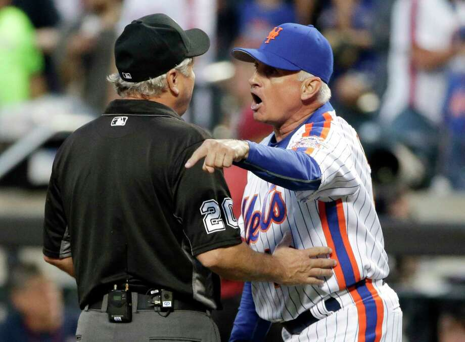 FILE - In this May 28, 2016, file photo, New York Mets manager Terry Collins (10) argues with umpire Tom Hallion after being ejected during the third inning of a baseball game against the Los Angeles Dodgers in New York. Commissioner Rob Manfred says Major League Baseball is trying to remove from the internet the leaked video of former Mets manager Terry Collins ranting at umpires. The profanity-laced video surfaced this week from a Dodgers-Mets game in May 2016 that Fox televised. (AP Photo/Frank Franklin II, File) Photo: Frank Franklin II / Copyright 2016 The Associated Press. All rights reserved. This m