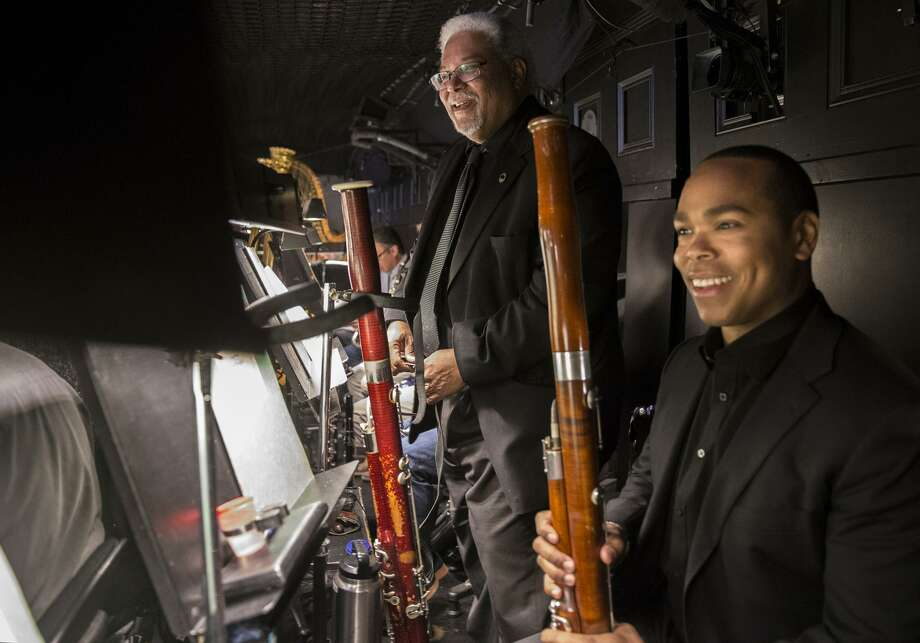Principal bassoonist Rufus Olivier Jr. and son Rufus David Olivier in the orchestra pit. Photo: Jessica Christian / The Chronicle / ONLINE_YES
