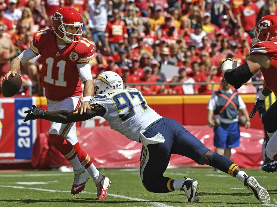 Pass rusher Jerry Attaochu (97), then of the Chargers, sacks Chiefs quarterback Alex Smith in 2016. Attaochu, who has joined the 49ers, hopes he'll get back to harassing quarterbacks. Photo: Peter G. Aiken / Getty Images / 2016 Peter G. Aiken