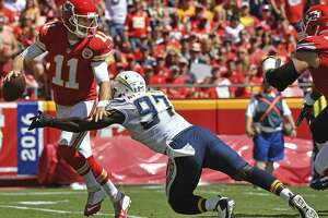Pass rusher Jerry Attaochu (97), then of the Chargers, sacks Chiefs quarterback Alex Smith in 2016. Attaochu, who has joined the 49ers, hopes he'll get back to harassing quarterbacks.