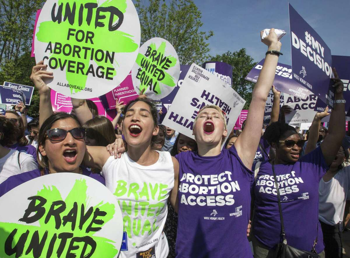 Abortion rights activists rejoice in front of the Supreme Court in Washington as the justices struck down the Texas law known as HB2, which required hospital admitting privileges for doctors.