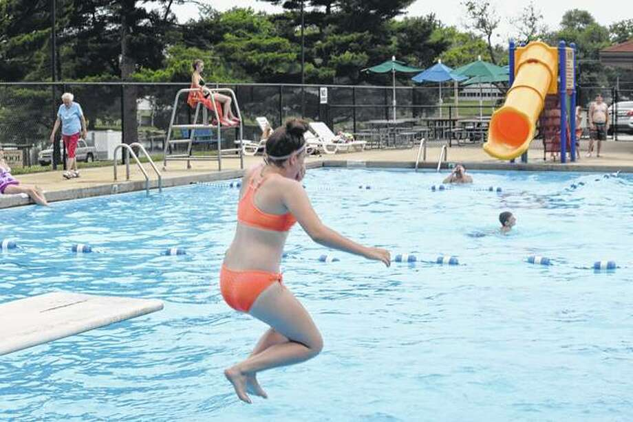 Hayley Murphy, 14, of Jacksonville jumps into the Nichols Park Pool on Thursday as the temperature rose into the mid-80s. The pool is open from 12:30 to 6 p.m. Sunday through Thursday and from 12:30 to 8 p.m. Friday and Saturday.