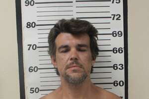 Michael Stage is accused of aggravated assault outside a Church's Chicken in Kirby.