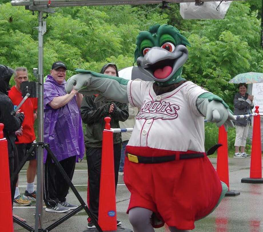 Lou E. Loon, mascot of the Great Lakes Loons, crosses the finish line Saturday morning at the Arc of Midland's 13th annual Stroll, Roll and 5K Run/Walk at Chippewa Nature Center. (Photo provided) / ©2018 Stuart Frohm