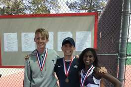 Tomball sophomore Ricardo Sanchez, left, placed first in boys singles and junior Blake Enstrom and senior Jennifer Gladias placed second in mixed doubles at the District 20-5A Tennis Tournament, April 9-11 at Tomball, to qualify to regionals.
