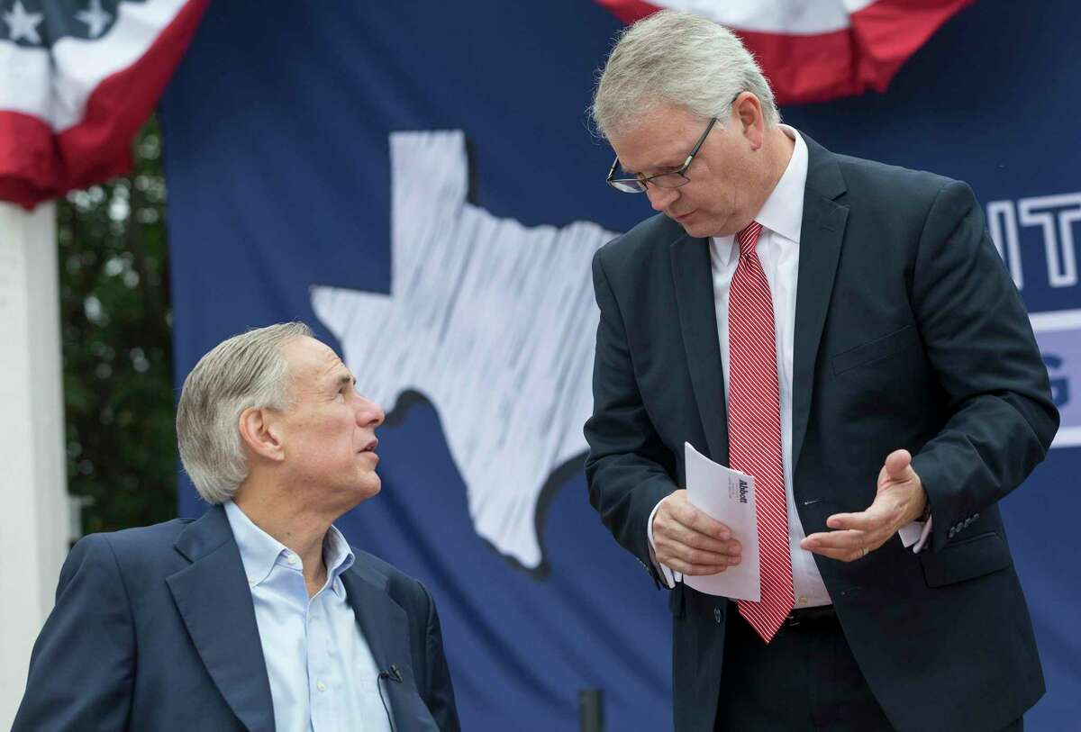 Gov. Greg Abbott shakes speaks with State Republican Party Chairman James Dickey during a picnic celebrating his reelection filing day announcement at The American Legion- Charles Johnson House in Austin Saturday, Nov. 11, 2017. (Stephen Spillman / for Express-News)