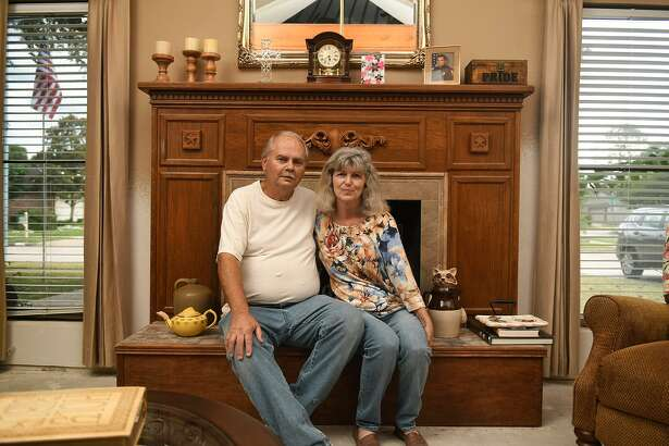 Jane, left, and Bill Wykoff sit in front of the fireplace of their still being rebuilt home post Hurricane Harvey in Houston on June 14, 2018. (Jerry Baker/For the Chronicle)