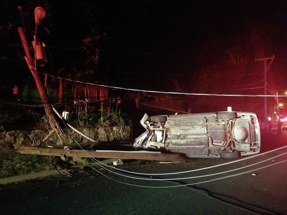 A motorist was extricated from their vehicle late Thursday after smashing into a utility pole on Town Hill Avenue. Photo: / Contributed