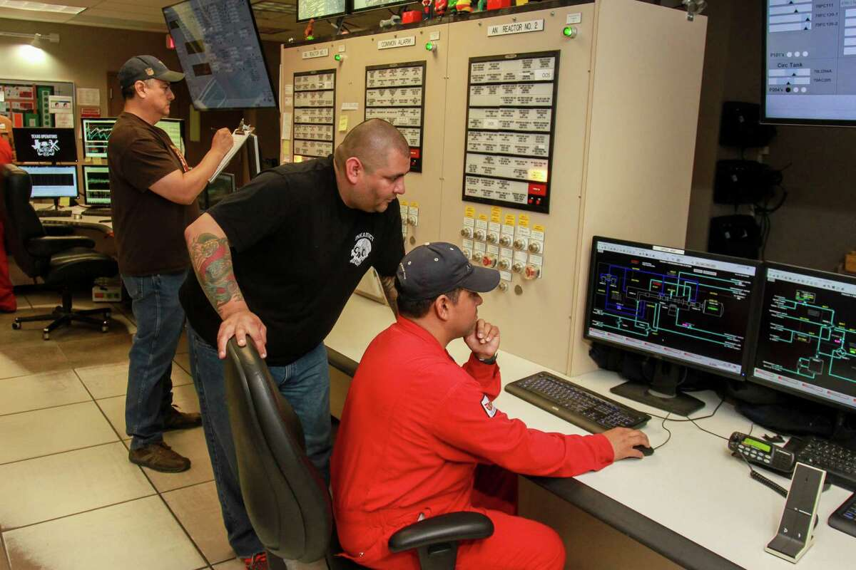 Javier Duarte, from right to left, Jacob Partida, and Daniel Rios in one of the control rooms that monitor process operations at the Ascend Performance Materials Chocolate Bayou Plant in Alvin, Texas.