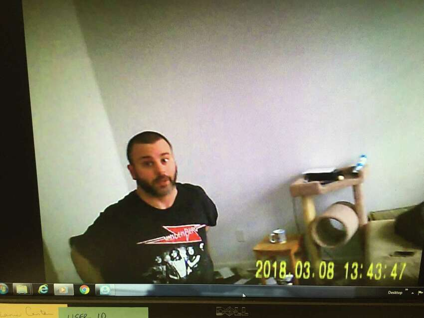 A screen grab from a police video taken by a confidential informant during a drug buy at Matthew Kirshner's Cohoes apartment in March. Kirshner, shown in black T-shirt, pleaded guilty to one felony count of attempted sale of a controlled substance, which will be reduced to a misdemeanor possession charge if he completes court-ordered treatment. (Courtesy Albany County Sheriff's Department.)