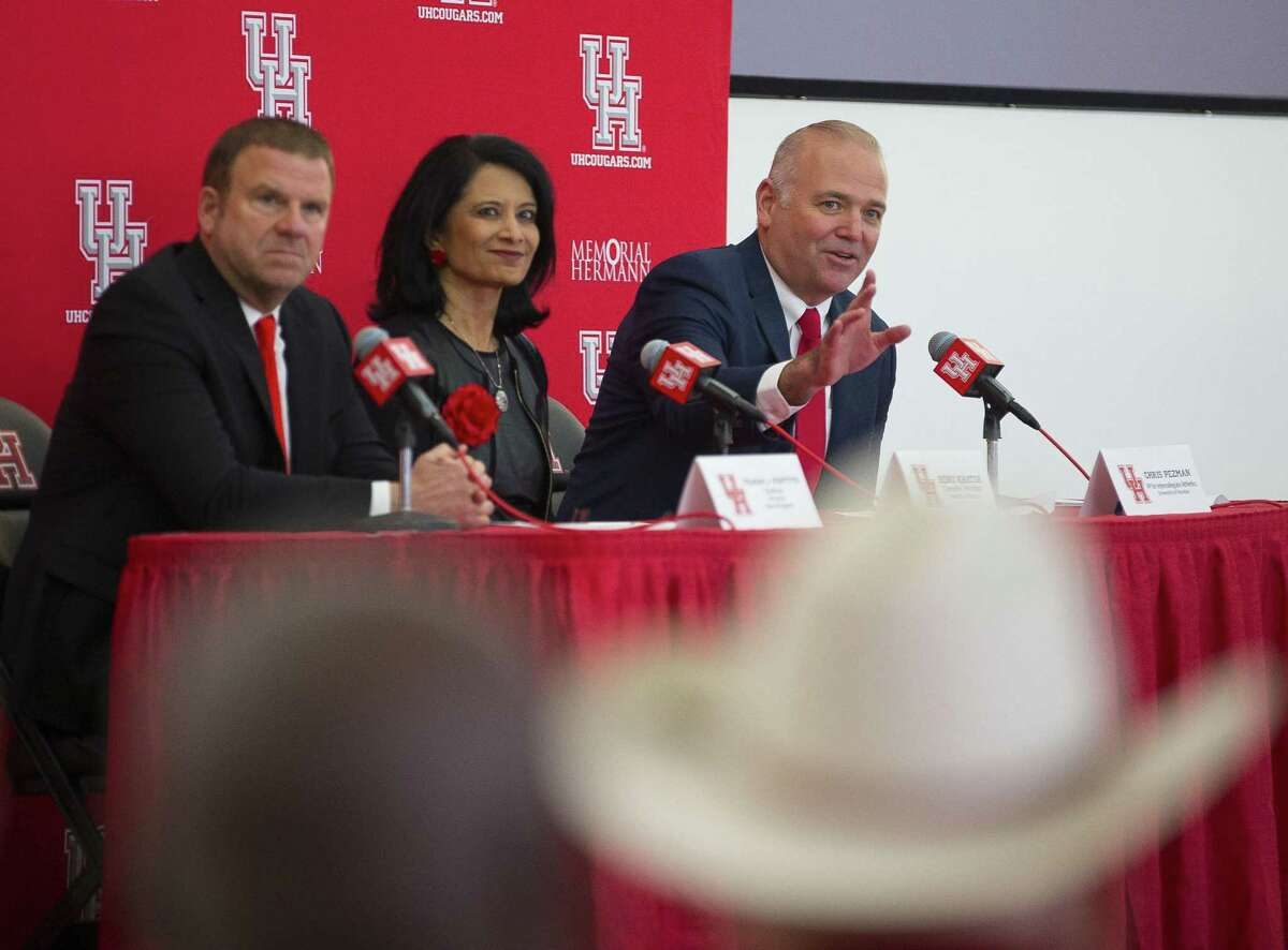 New University of Houston athletic director Chris Pezman with board chairman Tilman Fertitta and university chancellor Renu Khator.