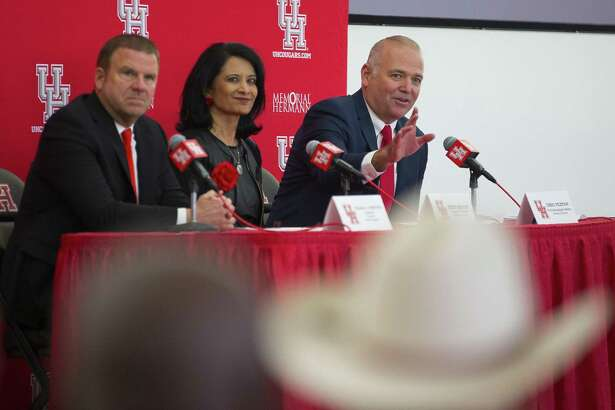 New University of Houston athletic director Chris Pezman (right) acknowledges the crowd during an introductory press conference with board chairman Tilman Fertitta and university chancellor Renu Khator at TDECU Stadium, Tuesday, Dec. 12, 2017, in Houston. ( Mark Mulligan / Houston Chronicle )