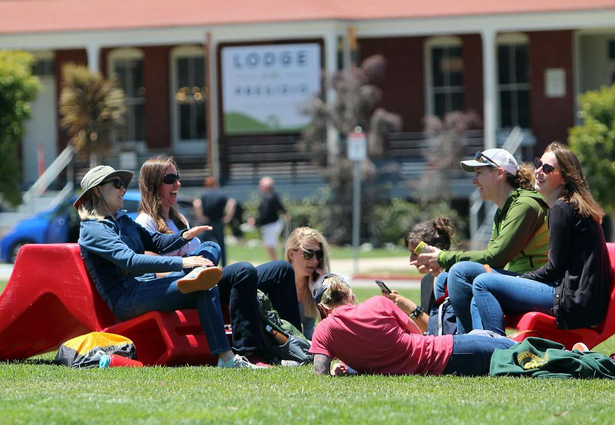 Workers, residents and visitors take advantage of a sunny day on what was once the parade grounds of the Presidio.
