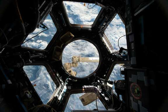 Earth is seen from the International Space Station. Many astronauts have spoken of the overview effect and how seeing the planet from space can change their perspective.