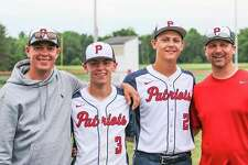 Two generations of two families have been best friends as well as Unionville-Sebewaing Area baseball teammates. That special bond of father and son, and the love of baseball is shared by, from left, Casey Riskey, his son, Devin Riskey, Brendan Prime and his father, Benjamin Prime. (Photo by Charles McGathy)