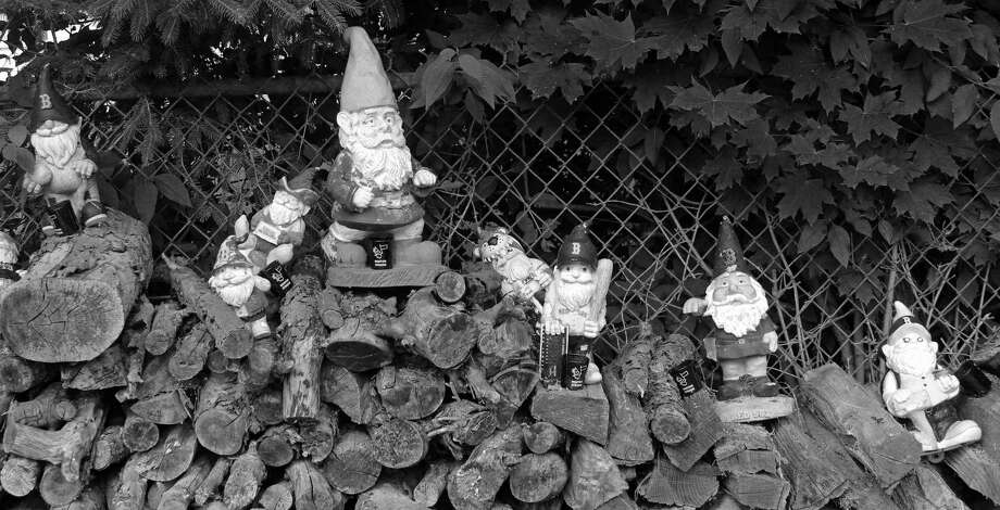 Gnomes atop a wood pile. Photo: Genevieve Reilly / Hearst Connecticut Media / Fairfield Citizen