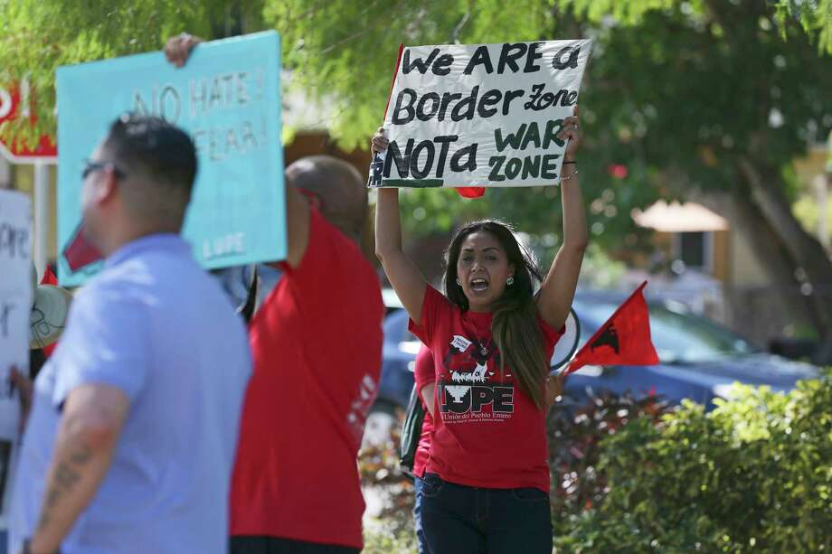 Evon Bueno, 38, joins a protest against the presence of Texas Department of Public Safety troopers and U.S. Border Patrol agents in the Southmost neighborhood of Brownsville, Texas, Friday, May 25, 2018. Photo: JERRY LARA, San Antonio Express-News / San Antonio Express-News