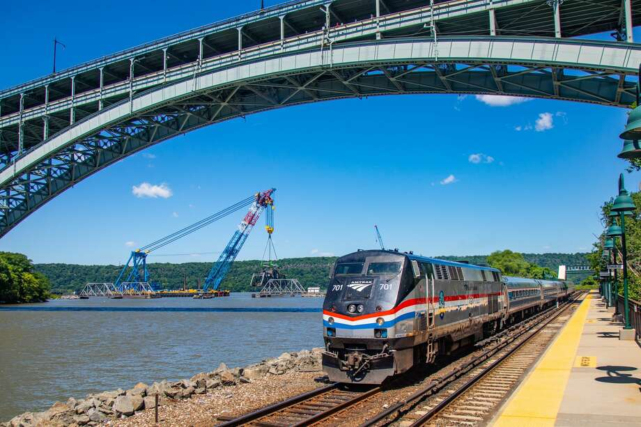 "Amtrak 236 passes the ""Left Coast Lifter"" Crane removing the Spuyten Duyvil Bridge on June 14, 2018
