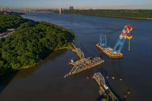 Spuyten Duyvil Bridge, Left Coast Lifter Crane in place   Amtrak workers used one of the world's largest floating cranes Thursday, June 14, 2018, to move the Spuyten Duyvil Bridge, which provides train access between upstate New York and New York Penn Station.