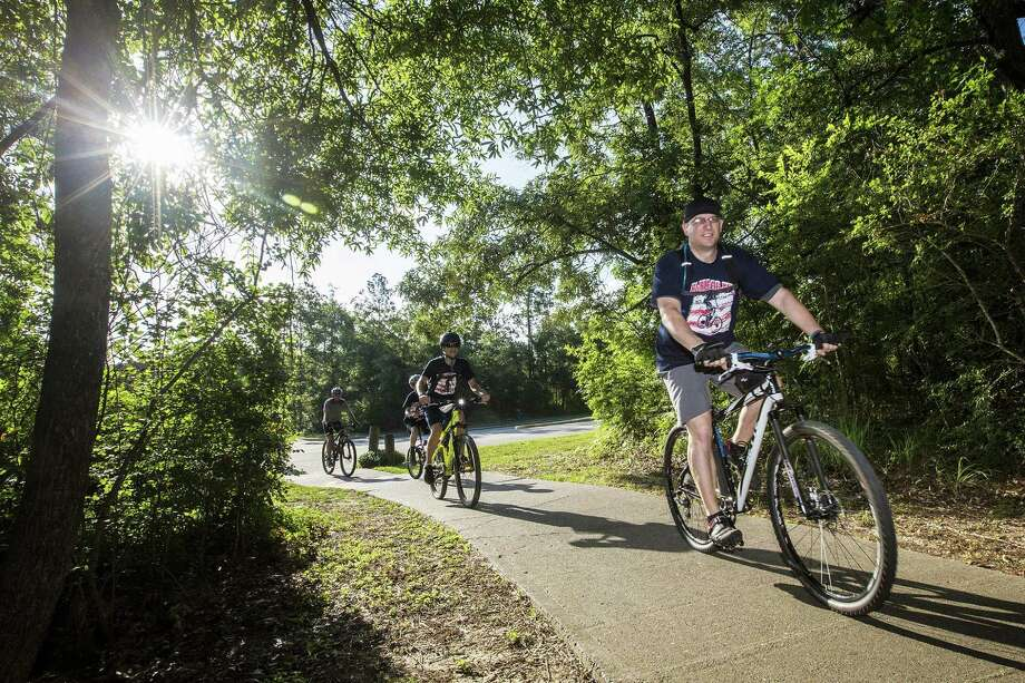 Gregg Hensley, ToppHeavvy president and Creekwood Middle School science teacher, leads the pack on their 9-mile Greenbelt Trails course during the 2nd Annual Vet Ride on May 24, 2014, in Kingwood. The ride through the Kingwood Greenbelt benefits the Humbe Area Veteran Honor Garden at Creekwood Middle School. Photo: ANDREW BUCKLEY / Internal