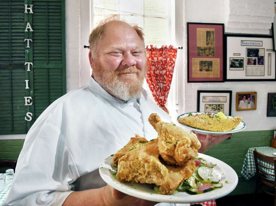 Chef Jasper Alexander with dishes of their signature fried chicken and fried catfish at Hattie's Restaurant on Phila Street Wednesday June 6, 2018 in Saratoga Springs, NY.  (John Carl D'Annibale/Times Union) Photo: John Carl D'Annibale / 20043984A