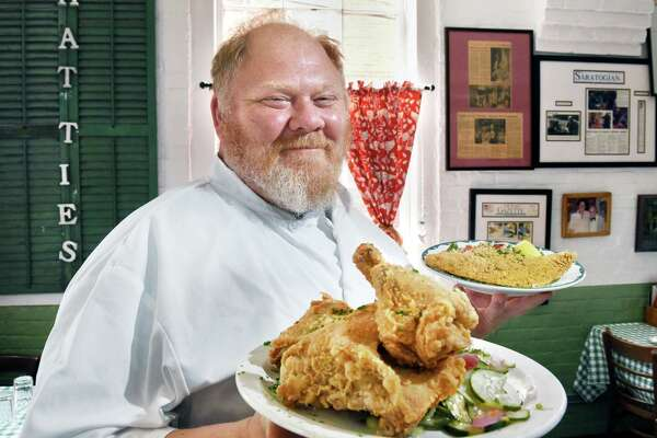 Chef Jasper Alexander with dishes of their signature fried chicken and fried catfish at Hattie's Restaurant on Phila Street Wednesday June 6, 2018 in Saratoga Springs, NY.  (John Carl D'Annibale/Times Union)