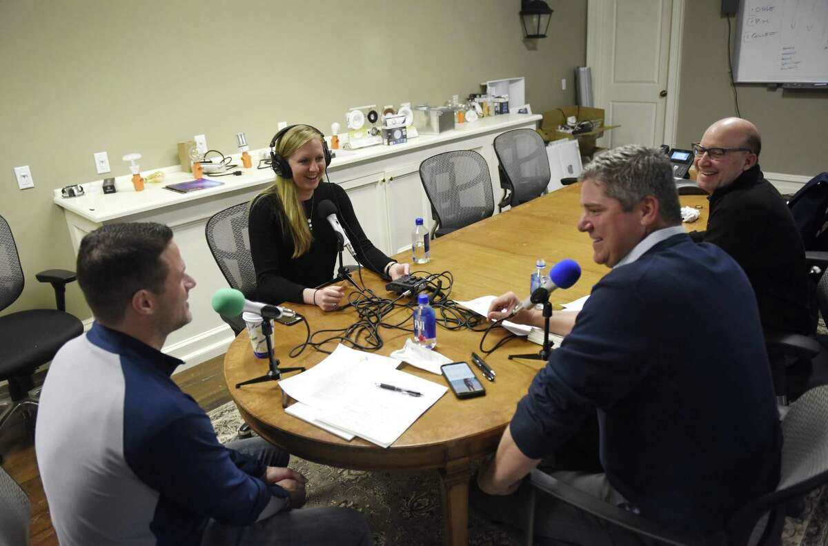 Hearst Connecticut Media business reporter Macaela Bennett interviews Tri-State LED Lighting President Ron Young, left, Vice President Bob Ostrander, center, and CFO Brooke Wagner during a recording of the new Rally podcast at Tri-State LED in the Byram section of Greenwich, Conn. Wednesday, April 4, 2018. Bennett is recording and producing a new podcast in which business people describe the challenges they've encountered in their rise to success.