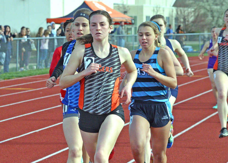 Edwardsville senior Lorie Cashdollar, middle, competes in the 800-meter run at the Tiger Invite on April 20 at the Winston Brown Track and Field Complex.