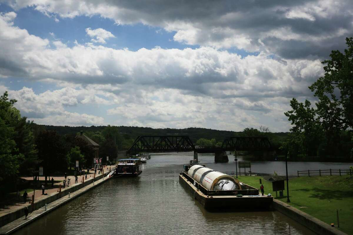 FILE N Large fermentation tanks belonging to the Genesee Brewing Company on a barge on the Erie Canal in Waterford, N.Y., May 19, 2017. On July 4, 1817, work began on an engineering marvel that, despite early derision, would become a symbol of New YorkOs political ascendancy. (Nathaniel Brooks/The New York Times) ORG XMIT: XNYT144