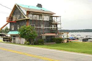 A lake front home gets an exterior renovation on Saratoga Lake on Wednesday, June 13, 2018 in Stillwater, N.Y. (Lori Van Buren/Times Union)