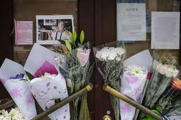 NEW YORK, NY - JUNE 8: Notes, photographs and flowers are left in memory of Anthony Bourdain at the closed location of Brasserie Les Halles, where Bourdain used to work as the executive chef, June 8, 2018 in New York City. Bourdain, a writer, chef and television personality, was found dead in his hotel room in France on Friday. His employer CNN confirmed the death as a suicide. (Photo by Drew Angerer/Getty Images)