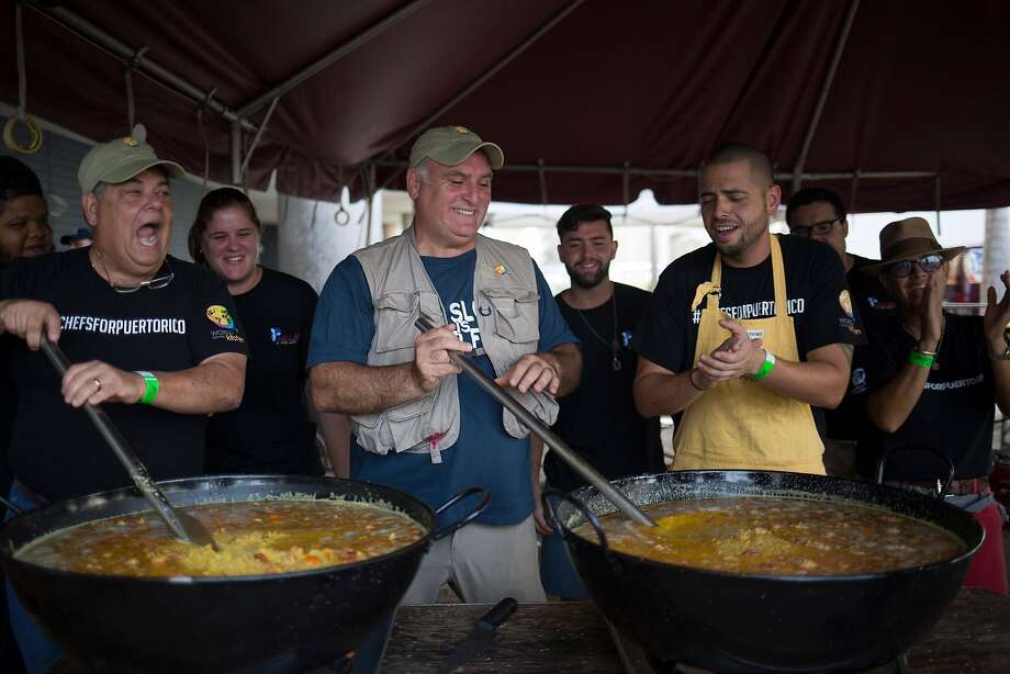 Chef José Andrés, center, and local chefs stir large pots of paella destined for people struggling to find enough to eat in the wake of Hurricane Maria, in San Juan, Puerto Rico, Photo: Eric Rojas / New York Times 2017