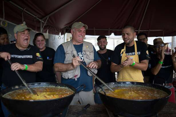 """The chef Jos� Andr�s, center, and local chefs stir large pots of paella destined for people struggling to find enough to eat in the wake of Hurricane Maria, in San Juan, Puerto Rico, Oct. 19, 2017. �We only came here to try to help a few thousand because nobody had a plan to feed Puerto Rico,"""" says Andr�s, """"and we opened the biggest restaurant in the world in a week. That�s how crazy this is.� (Eric Rojas/The New York Times)"""