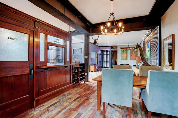 """An """"industrial glam"""" condo for sale on Houston's south side near Brays Bayou comes with real pennies embedded into the floor of the master bedroom and a salvaged U.S. Post Office door, desk and window nearby. Going for $359,000, the home can come fully-furnished to the new owner for an additional fee if they wish, according to realtor Tiffany Curry who is handling the sale of the condo for Berkshire Hathaway. The two-bedroom, two-bathroom condo also has an attached garage and on-site pool."""