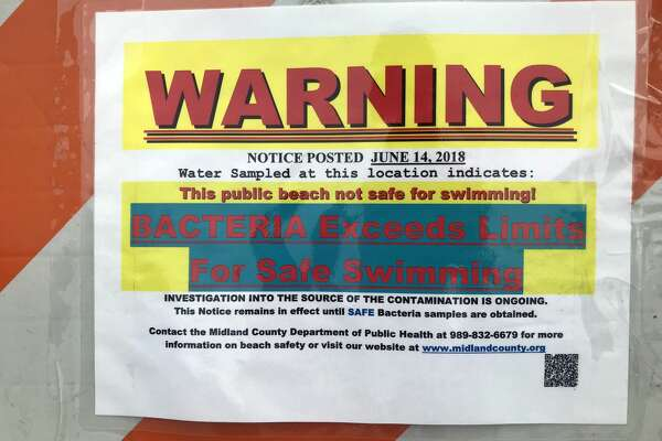 Signs at Stratford Woods warn of high bacteria levels on Friday, June 15, 2018. (Kate Carlson/kcarlson@mdn.net)
