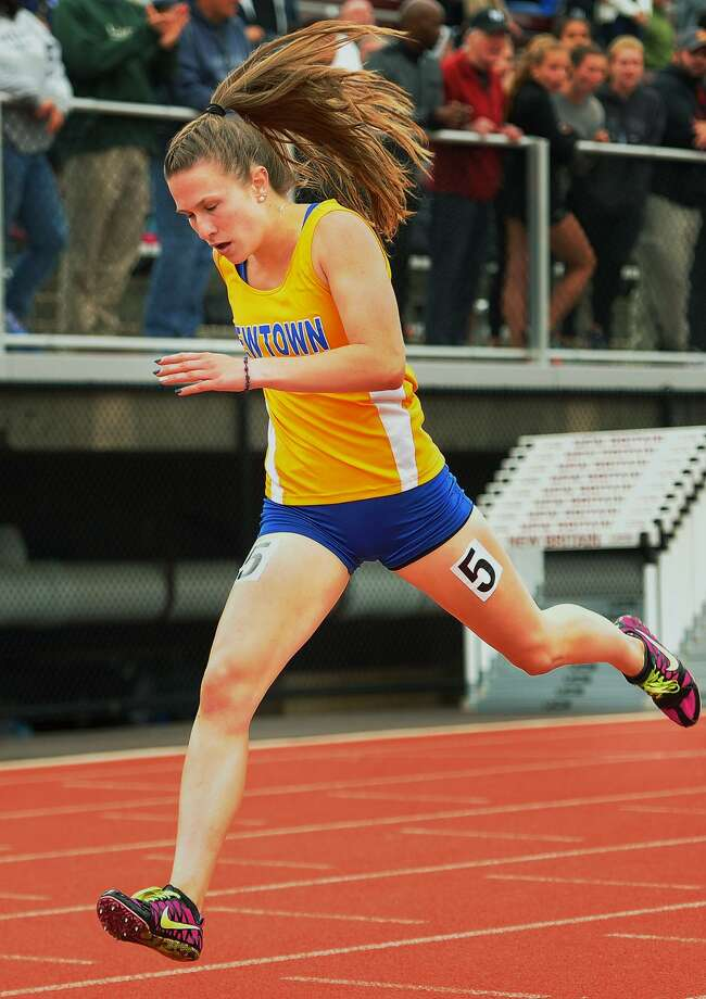 Newtown's Carly Swierbut crosses the finish line to win the girls 400 meters at the CIAC Track & Field Championships in New Britain, Conn. on Monday, June 4, 2018. Photo: Brian A. Pounds / Hearst Connecticut Media / Connecticut Post