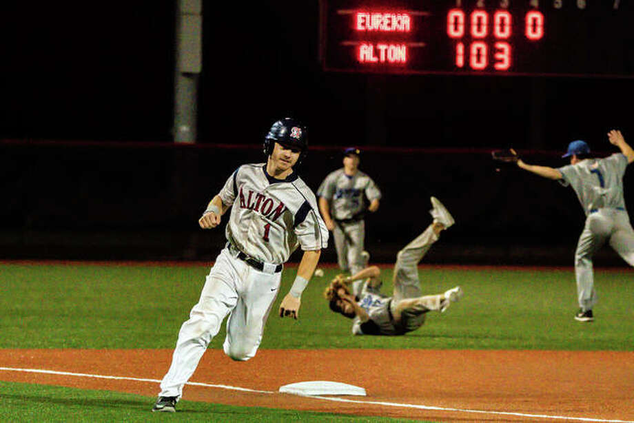 Alton Post 126's Ethan Kopsie rounds third base Tuesday night in an 8-2 victory over Eureka Post 177 at Roy E. Lee Field in Edwardsville.