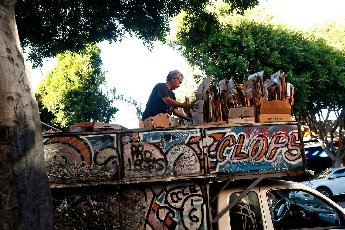 Jose Macias folds cardboard boxes on his truck parked on 24th Street in the Calle 24 Latino Cultural District in San Francisco, Calif., on Sunday, October 22, 2017.