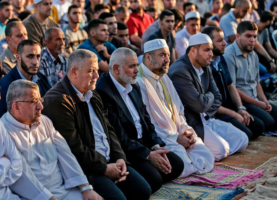 Hamas leader Ismael Haniyeh (third from left) attends prayers during the Eid al-Fitr celebration. Photo: Mahmud Hams / AFP / Getty Images