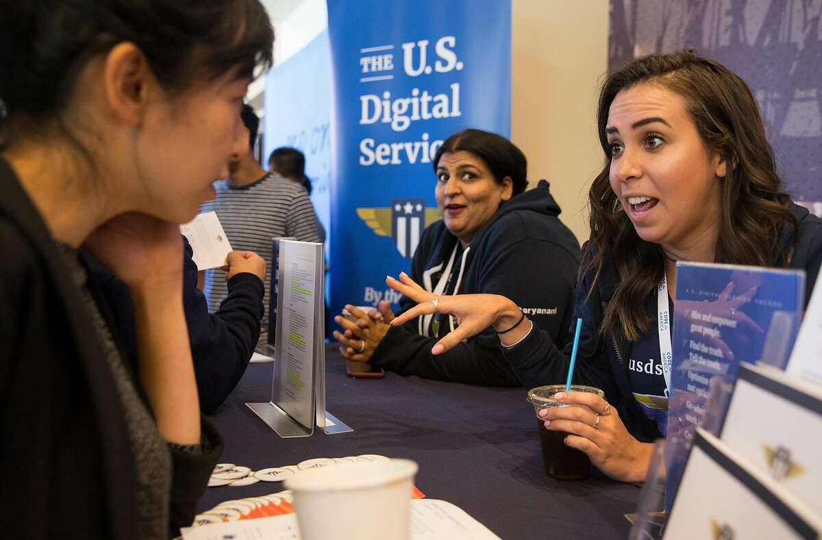 U.S. Digital Service recruiter Andrea Visa, right, chats with a conference attendee during the Code for America conference at the Oakland Marriott City Center in Oakland, Calif. Thursday, May 31, 2018.