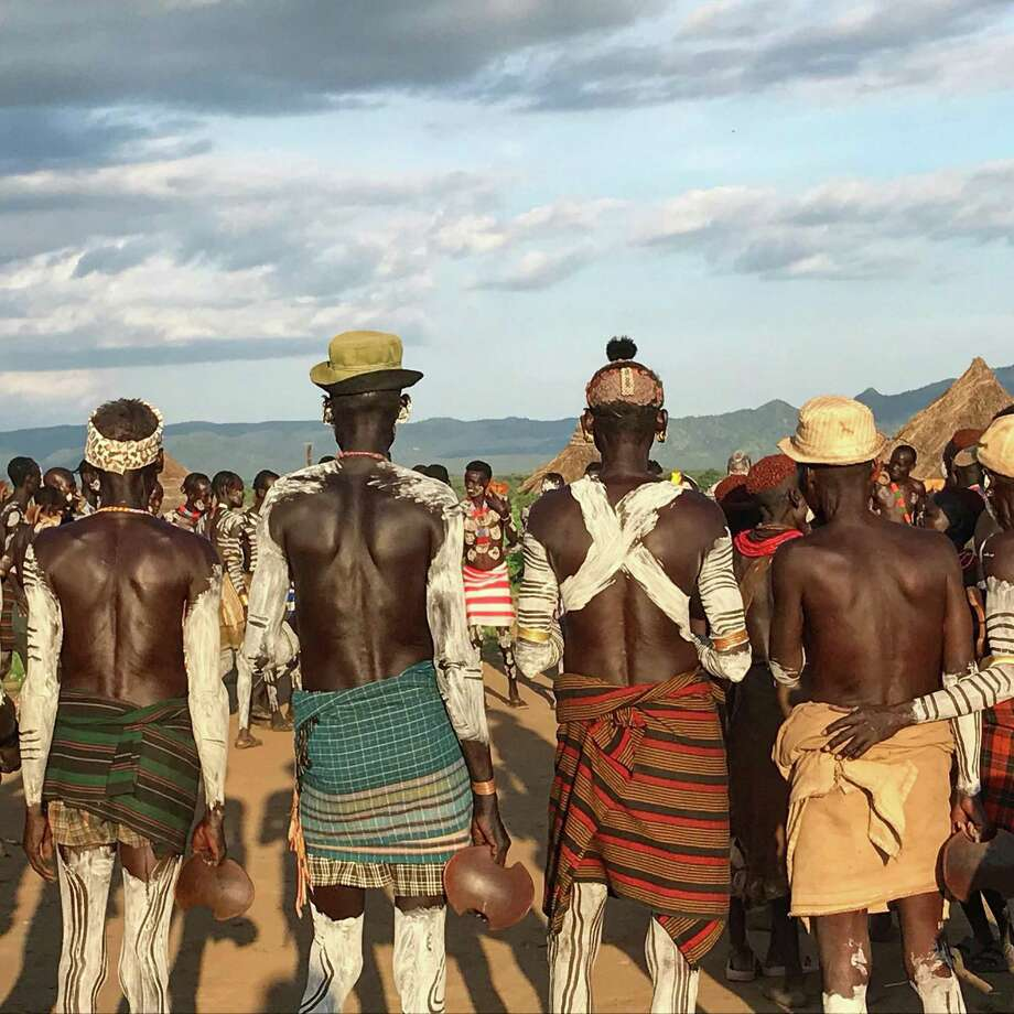Members of a Karo tribe gather for a ceremony at Lale's Camp in Omo Valley, Ethiopia. Photo: Jen Murphy / Jen Murphy