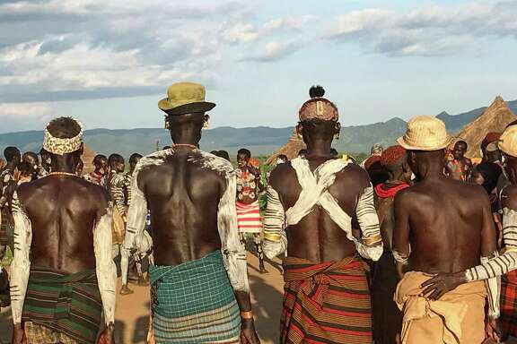Members of a Karo tribe gather for a ceremony at Lale's Camp in Omo Valley, Ethiopia.